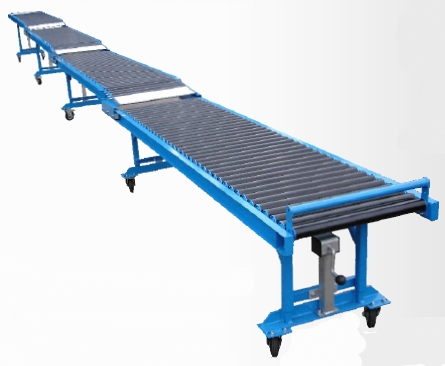 Low level trailer unloading conveyor
